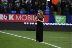 Remembering the 33: Joanna performs at the Macron Stadium, in memory of the Burnden Park Tragedy